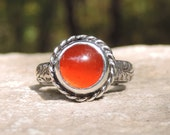 Ornate sterling ring with round orange carnelian cabochon