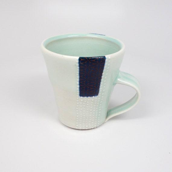 Celadon glazed porcelain latte mug with blue patterned rectangle