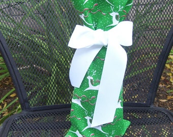 Wine Wrap/Wine Bag with white reindeer in a green forest