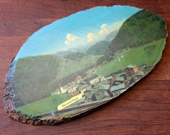 Swiss Village in the Alps. Vintage souvenir wood log wall plaque.