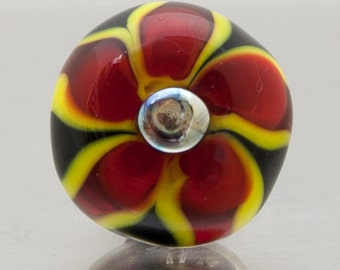 Glass scatter pin - Flower in red, yellow and black. Lampwork glass by Jennie Yip