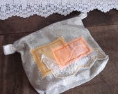 OOAK Make-up bag in recycled and vintage fabrics. In our abstract design. Pastel Orange and Ivory