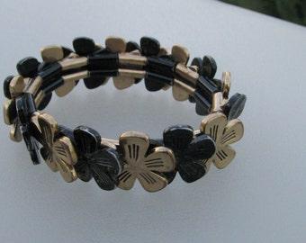 Gold and Black Metal Bracelet