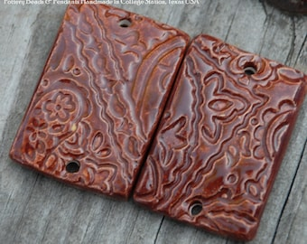 2 Large Rectangle Curved Beads in Rust Red with a Paisley Design