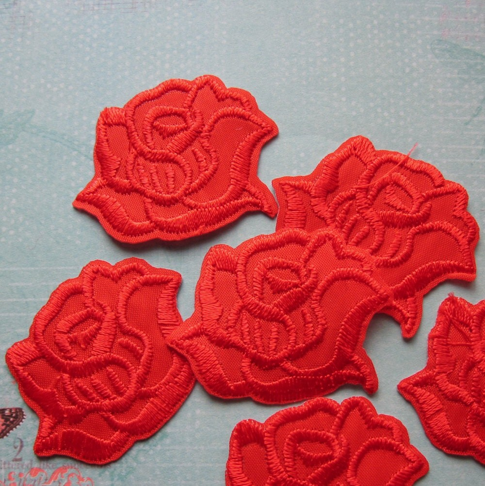 Pieces of embroidered red rose iron on patches by