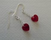 E 555 Earrings with siam Swarovski hearts.