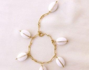 white jade with gold bracelet.
