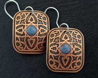 copper leaf dangles, domed earrings, dark copper earrings, metalsmith earrings, artsy earrings, metalsmith jewelry, blue copper earrings