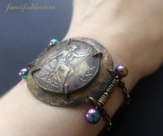 Ya'aburnee. Rustic assemblage bracelet with large coin.