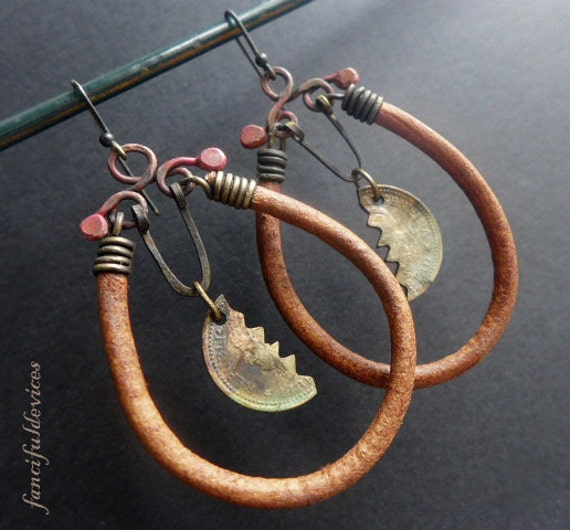 Abask. Rustic assemblage earrings with cut coins and leather cords.