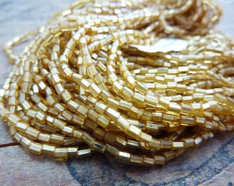 Antique Silver Lined Gold Seed Bead SB1041