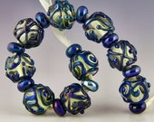 set of 9 round beads in clear with iridescent blue designs no two alike handmade lampwork glass includes 10 spacers - Blingle