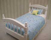 One Inch scale, White Single Bed dressed in blue, white and yellow stars and moon pattern bedding.