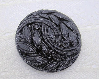 "Pretty Molded Black Glass Button Czechoslovakia 1 & 1/4"" across"