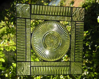 Clear stained glass window panel with plate