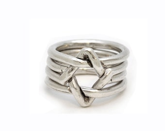 Star Of David   4 piece puzzle ring   Sterling   small star of david puzzle ring. Unisex. For Bar / Bat Mitzvah or for Jewish holidays.