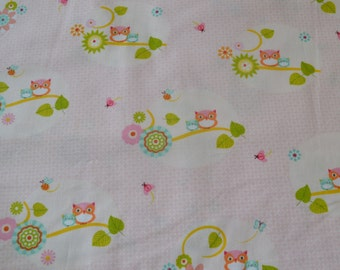 A Yard of Whoos Owl is On The Branch Fabric With a Pink Background