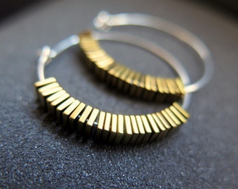 sterling silver and gold earrings. hammered hoops with yellow gold hematite stones.