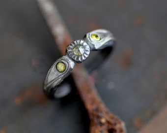 Relic ring, a sterling silver ring with engraved and milgrain details, yellow rose cut diamond and brilliant cut diamond