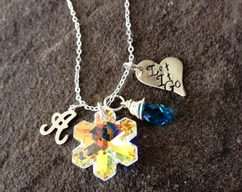 Frozen inspired let it go stamped necklace with Swarovski snowflake charm