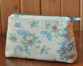 Romantic, ivory linen floral makeup, accessory bag.