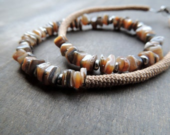 Tiny square pieces of shells combined with silver and caramel crochet tubes