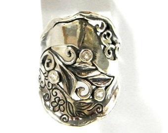 Sterling silver ring set with cz stones. Israeli designer Nature motif ring.