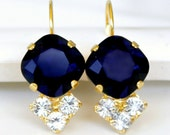 Dark Indigo Blue Swarovski Crystals with Three Brilliant Clear Crystals on Gold Leverback Earrings