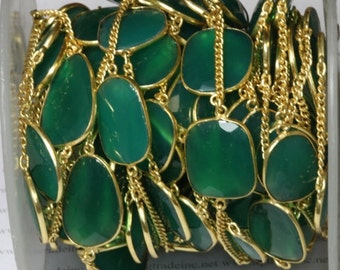 green  setting with gold plated chain.