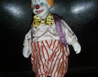 """Clown: Music Box 12"""" Tall  Circus Clown in Motion Music Box Doll Porcelain  Self Standing"""