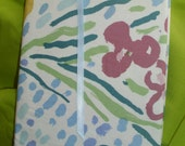 Spring Colors of Blue, Green, Plum and White grace this fabric covered journal