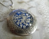 Peace-Pressed Flower Keepsake Locket-Queen Anne's Lace-Glowing Royal Blue Background-Symbolizes Peace-Nature's Wearable Art