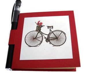 Bicycle with  Wicker basket of red pansies Post it Note Holder with gel pen