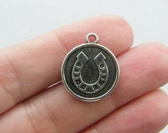 6 Horseshoe charms tibetan silver A544