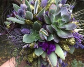 Succulent bouquet with purple/ eggplant and peacock feathers