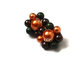 vintage earrings 1950s bead cluster flower setting orange green clip ons