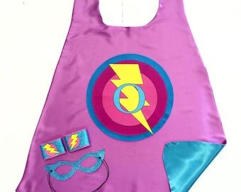 Fast Shipping - GIRL CUSTOM LETTER 3 Piece Superhero Cape Set - Super Bolt cape plus Sparkle Wrist Bands and Sparkle Super Hero Mask