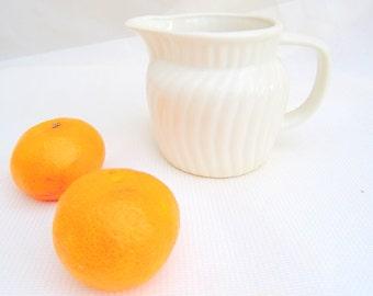 vintage white ceramic creamer.pitcher.ridged.tessiemay