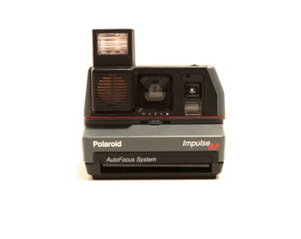 polaroid IMPULSE camera TIMER so you can jump in the picture WORKS perfectly