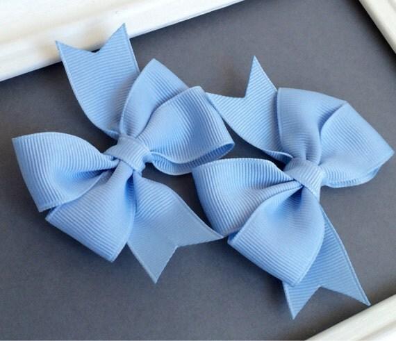Blue Hair Bow:   Set of two pinwheel style millenieum blue bows