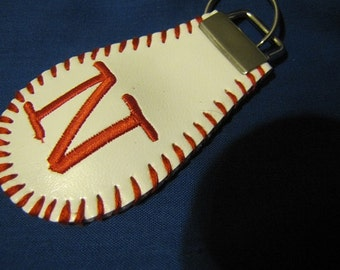 Keychain made from a baseball, embroidered with your initial and laced to match