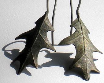OFF THE BENCH . cast oak leaf . bronze . sterlings silver . earrings