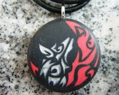 Blood Wolf moon hand carved on a polymer clay black color background. Pendant comes with a FREE necklace