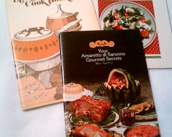 3 recipe booklets with Sunset salads, Oster fondue, and Amaretto gourmet secrets