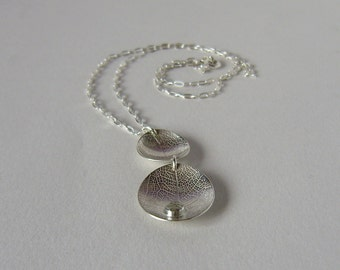 Silver two leaf dishes necklace with white topaz