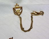 Coro Pegasus 1940s door knocker and hand double gold tone brooch