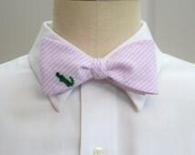 Men's Bow Tie in pale pink seersucker with green embroidered alligator (self-tie)
