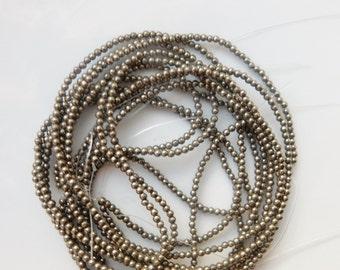 2mm Pyrite round beads FULL STRAND