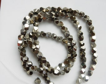 Pyrite nugget beads, faceted  (5-6mm), FULL STRAND