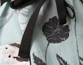 Linen apron hand printed in black,gray and light turquoise with poppies and leaves